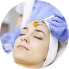 woman receiving acne treatment at spa